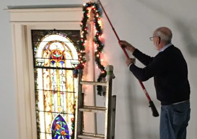 Ron hanging some lights